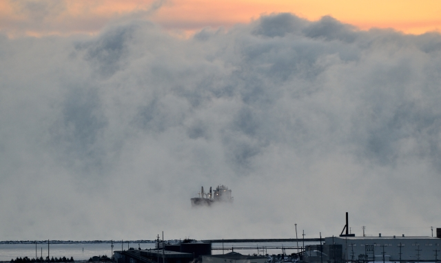 SHIP ENGULFED IN EARLY MORNING MIST Freezing air temperatures colder than lake water causes mist until ice sets in.