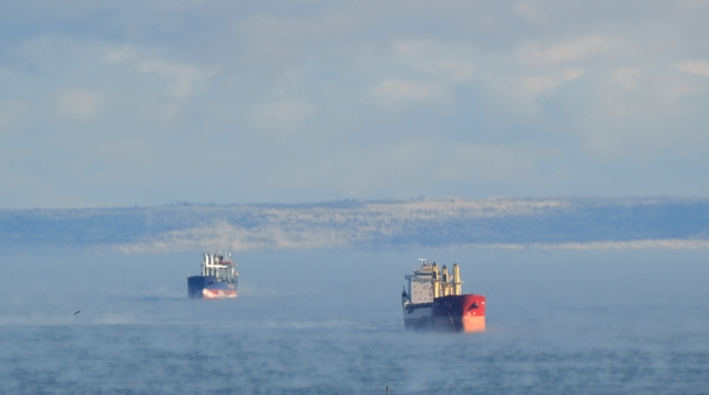 TWO SHIPS IN DAYLIGHT MIST
