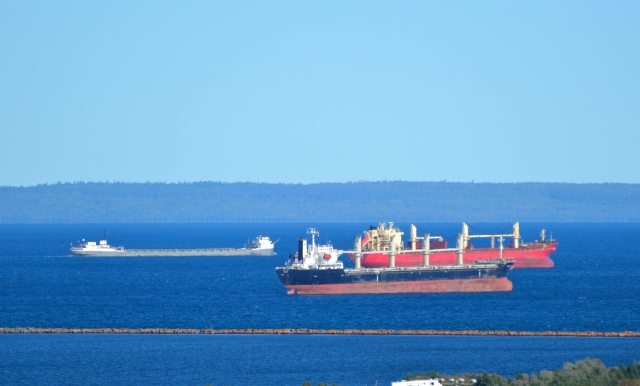 1 LOADED, LOW & UNDERWAY. 2 ANCHORED, EMPTY, RIDING HIGH & AWAITING BERTH