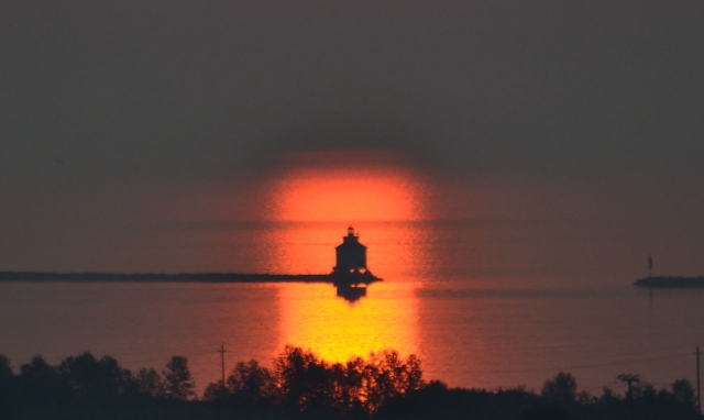 LIGHTHOUSE IN THUNDER BAY'S SUNRISE REFLECTION